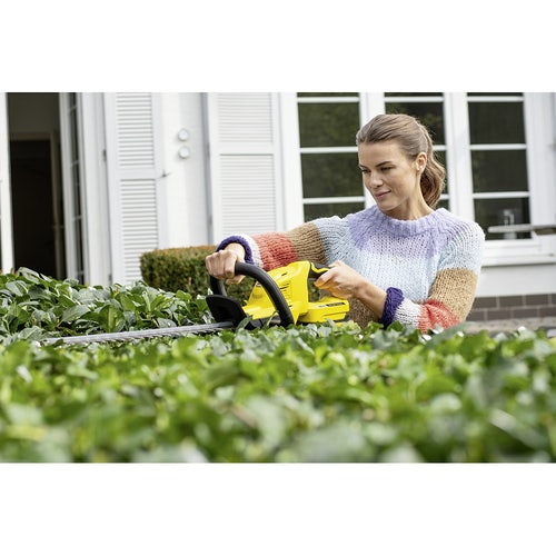 Karcher Battery Powered Hedge Trimmer 18 45 Set with Battery Lifestyle Image 1