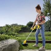 Karcher Battery Powered Lawn Trimmer 18 25 Machine Only Lifestyle 2