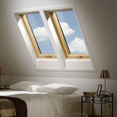 Fakro FTP - V P2/02 Pine Centre Pivot Window Laminated - 55cm x 98cm