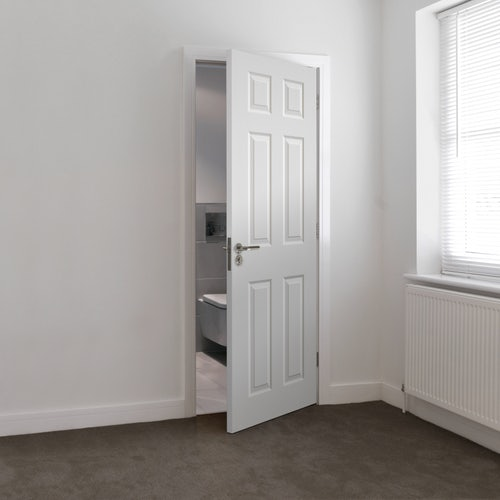 jb-kind-white-primed-colonial-4-panel-extreme-door-lifestyle